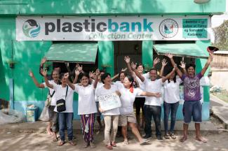 People standing in front of Plastic Bank