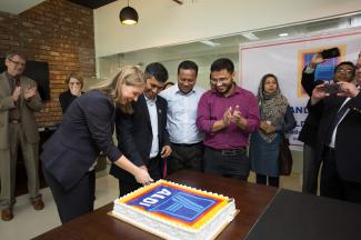 Anke Ehlers cutting cake on the opening of the Bangladesh CR office