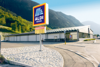 ALDI SUISSE store with mountains in the background