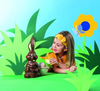 Little girl with Easter chocolate bunny