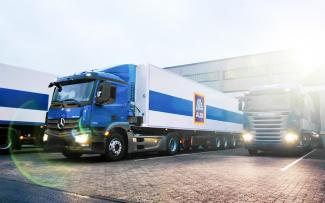 ALDI logistics vehicles in front of a regional distribution centre