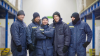 Frontal photograph of five ALDI employees in protective gear occupied in the chiller area of an ALDI regional distribution centre